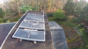 Solar panels to heat water for a residential dwelling.