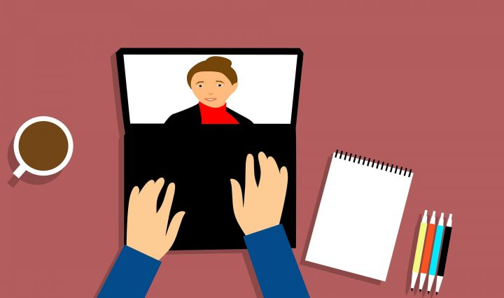 Illustration of webinar being displayed on a laptop. A pair of hands hovering over the laptop with a picture of a woman on the video screen. Also a notepad with colorful markers to the right. A cup of coffee to the left.