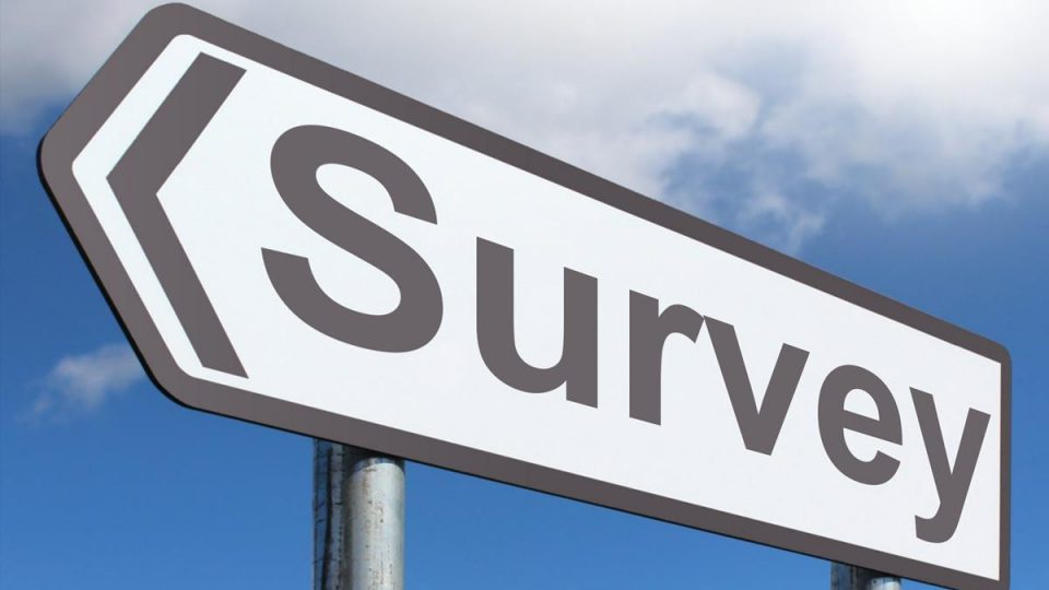 """A highway sign that reads """"Survey"""""""