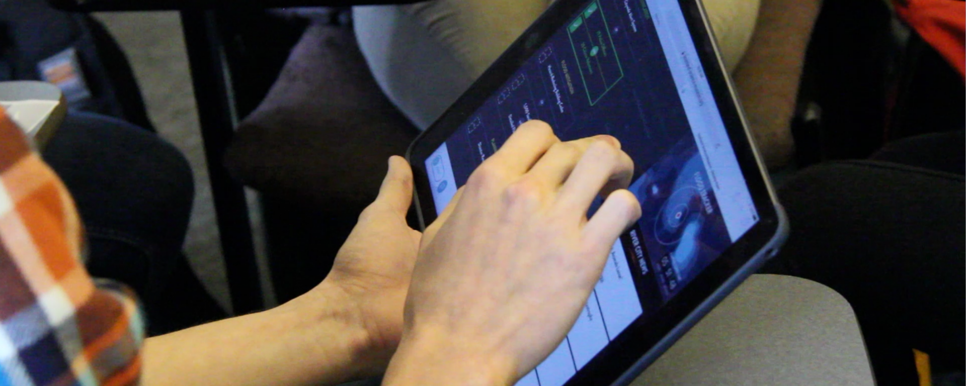 Student using iPad in class