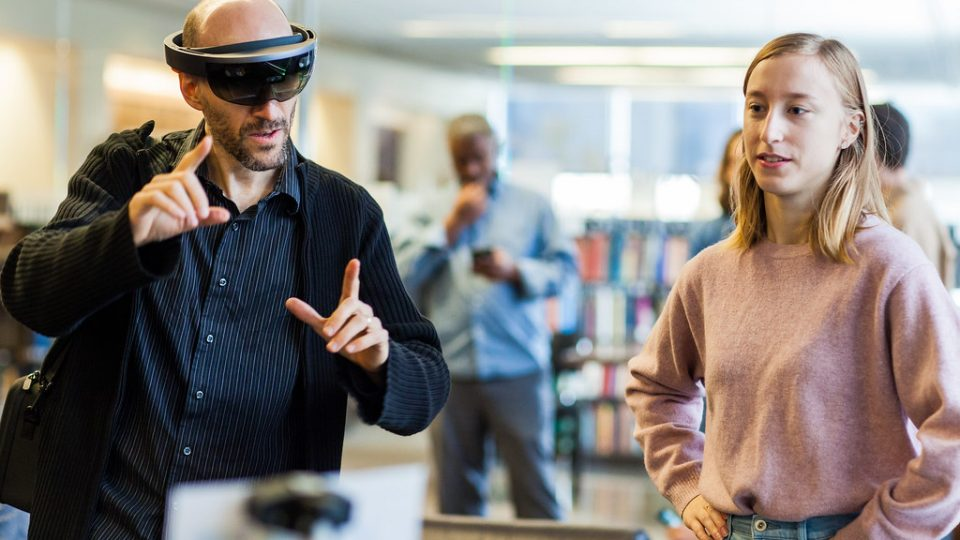 two people use an augmented reality visor