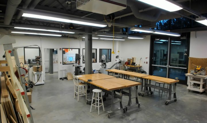 The MakerSpace interior with work tables and woodshop machines.