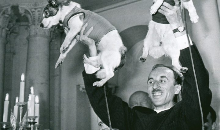 Former director of the Institute of Biomedical Problems, Oleg Georgievich Gazenko, holds up Soviet space dogs Belka and Strelka.