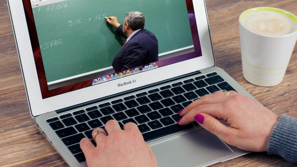 Laptop showing a video of a professor teaching