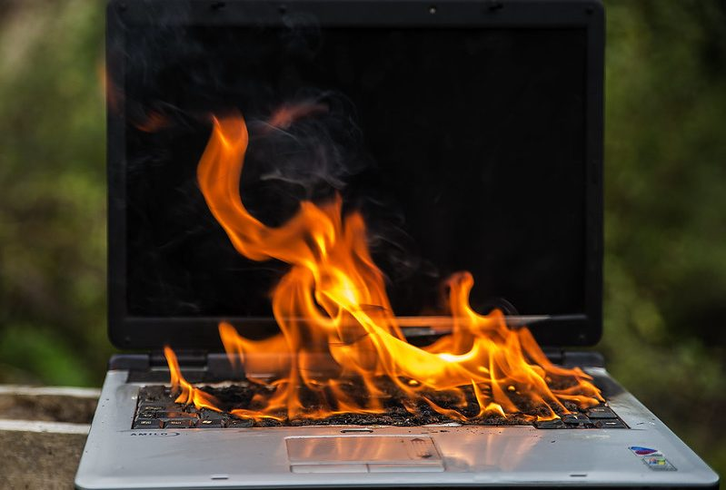 photo of a computer on fire