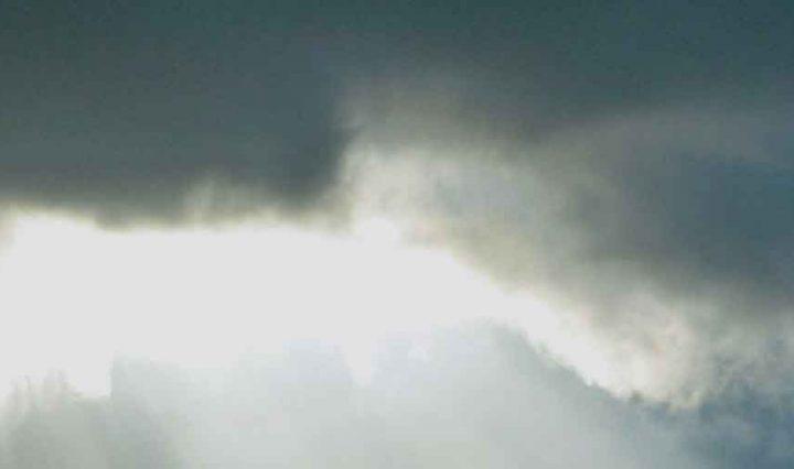 dark clouds with sun shining through