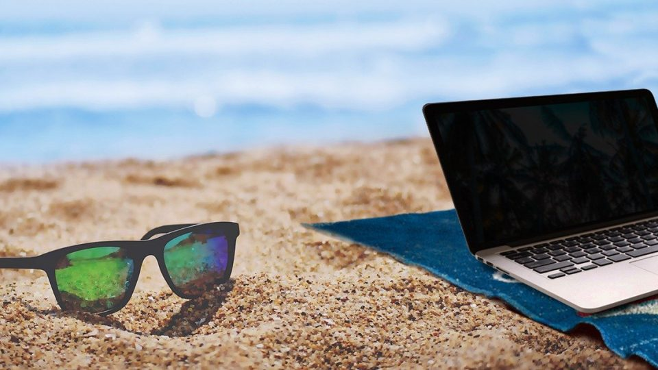 Laptop computer sitting on a beach